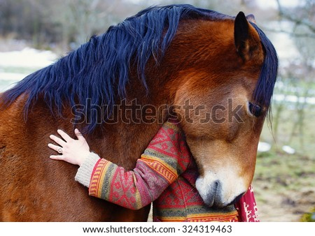 Portrait woman and horse in outdoor. Woman hugging a horse  - stock photo