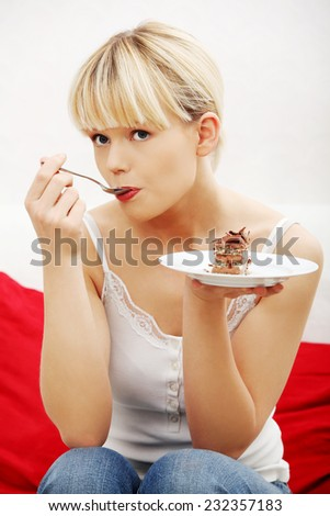 Portrait woman eating piece of cake. - stock photo
