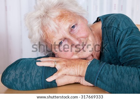 Portrait, woman lays head on hands - stock photo
