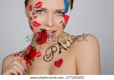 Portrait woman with glasses on theme of France and Paris isolated on white - stock photo