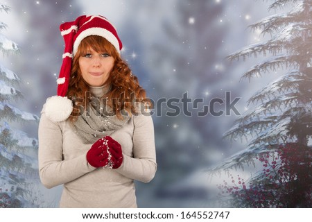portrait woman with red Santa Claus hat making snow ball - stock photo