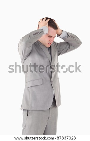 Portrait worried young entrepreneur against a white background - stock photo