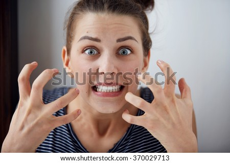 Portrait young angry woman unhappy, annoyed by something Human face expression emotion reaction - stock photo