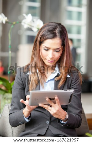 Portrait young attractive businesswoman working with digital tablet. - stock photo