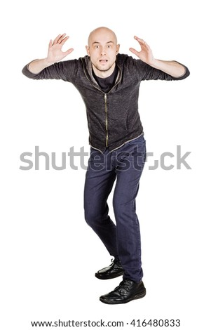 portrait young bald man defending himself from something. emotions, facial expressions, feelings, body language, signs. image on a white studio background.  - stock photo