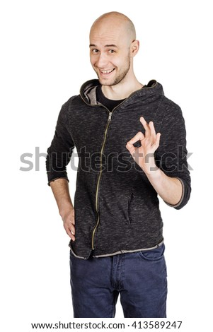 portrait young bald man showing ok hand sign. emotions, facial expressions, feelings, body language, signs. image on a white studio background. - stock photo