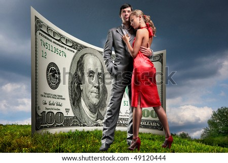 Portrait young beautiful couple. money, 100 american dollars - stock photo