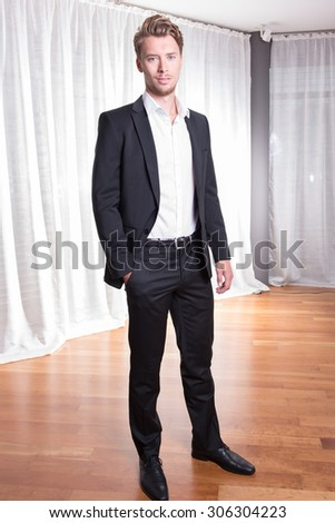 Portrait young business man in suit - stock photo