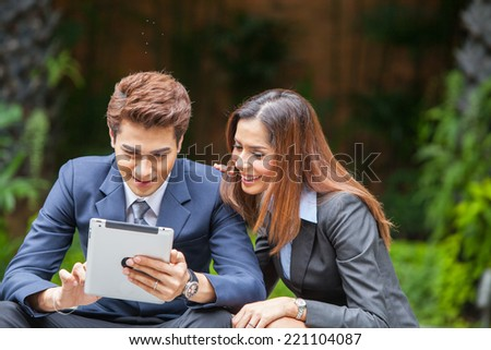 Portrait young businesspeople working outdoor. - stock photo