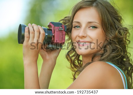 portrait young charming long-haired curly woman holding hands camera background outdoors - stock photo