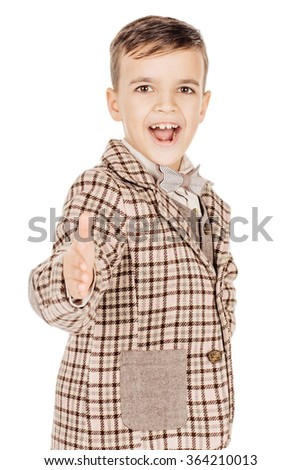 Portrait young happy boy looking at camera isolated on white studio background. - stock photo