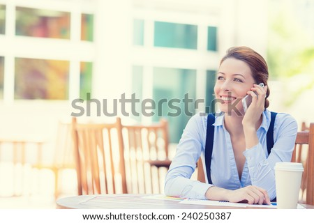 Portrait young happy smiling woman talking on mobile phone outside corporate office building isolated city background college campus. Positive human face expression emotion life success concept - stock photo