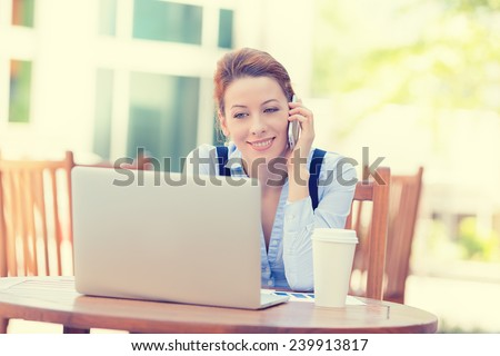 Portrait young happy woman talking on mobile phone working on computer laptop outside corporate office isolated city background college campus. Positive human face expression, emotion, success concept - stock photo