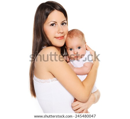 Portrait young lovely mother with her infant  - stock photo