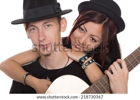 Portrait young musicians with guitar. Interracial young couple, Asian woman and Caucasian man. - stock photo