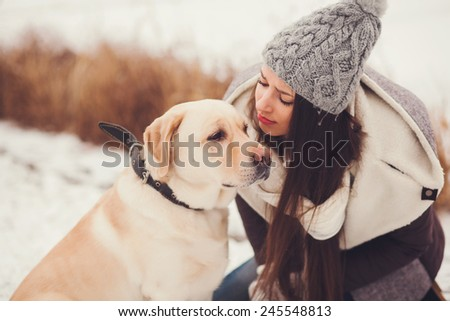 Portrait young woman and her labrador - stock photo