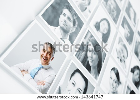Portraits of a group of people smiling - stock photo