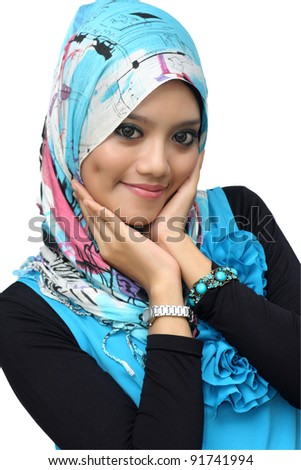 Portraits of cheerful young muslim woman over white background - stock photo