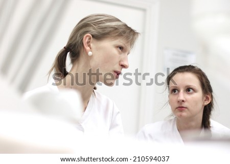 Portraits of health care workers having conversation in clinic - stock photo