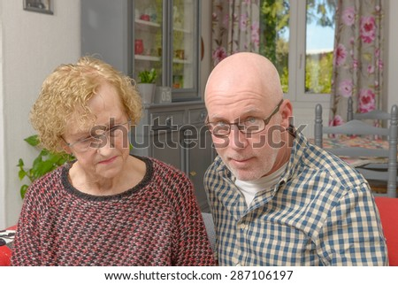 portraits of the mother and her adult son in his home - stock photo