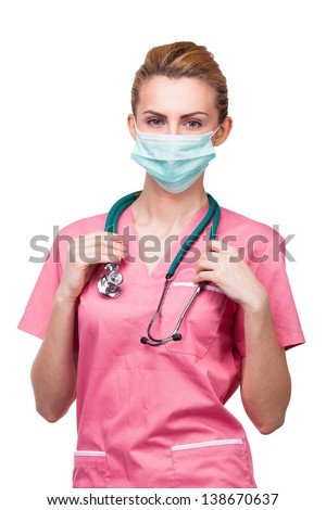 portret of young medic with medical mouth protection and stethoscop - stock photo