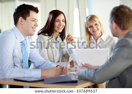 Portriat of confident business people interacting at meeting - stock photo