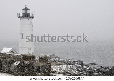 Portsmouth Harbor Lighthouse in snowstorm on the New Hampshire coast. - stock photo