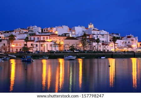 Portugal Algarve Region Ferragudo picturesque fishing town after dusk - stock photo