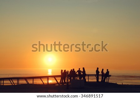 Portugal and the sunset at its best.  Costa da Caparica is a Portuguese civil parish, located in the municipality of Almada along the western coast of the district of Setubal. - stock photo