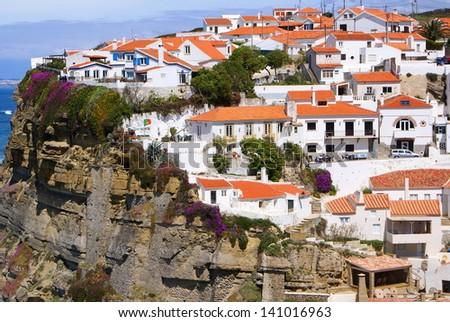 "Portugal ""Azenhas do Mar"" near Lisbon village built on a cliff-top overlooking the Atlantic Ocean - stock photo"