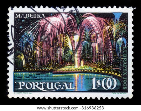 PORTUGAL - CIRCA 1968: A stamp printed in Portugal shows fireworks over Funchal on the island of Madeira, circa 1968 - stock photo