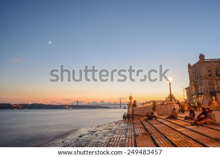 Portugal, Europe - The Columns Wharf Viewpoint at commerce square downtown at sunset in city of Lisbon (long exposure) - stock photo