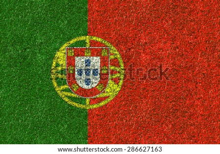 Portugal flag texture on green grass in the garden for background - stock photo