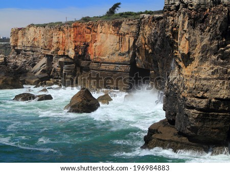 """Portugal, Lisbon, Cascais, Rugged cliff formations and a wild sea at """"Boca do Inferno"""" a popular tourist destination on the Atlantic Coast. - stock photo"""