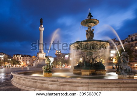 Portugal, Lisbon, Rossio Square by night with Baroque fountain and Column of Dom Pedro IV - stock photo