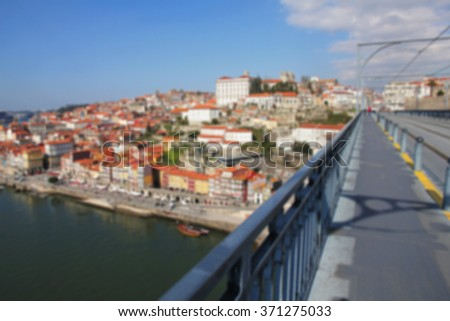 Portugal. Porto city. View of Douro river embankment in the morning. Dom Luis I bridge. In blur style    - stock photo
