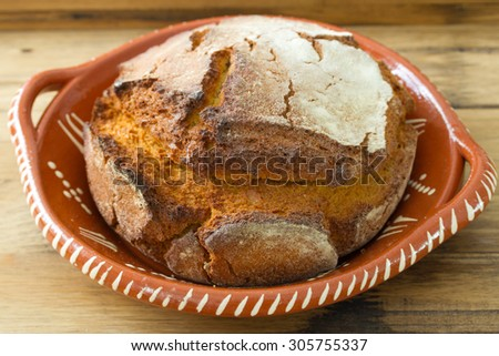 portuguese cornbread on brown wooden background - stock photo