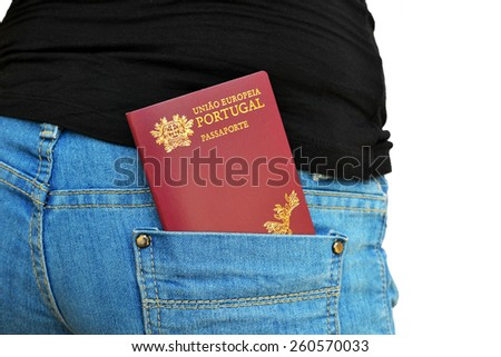 Portuguese passport shown in a rear pocket of jeans pants - stock photo