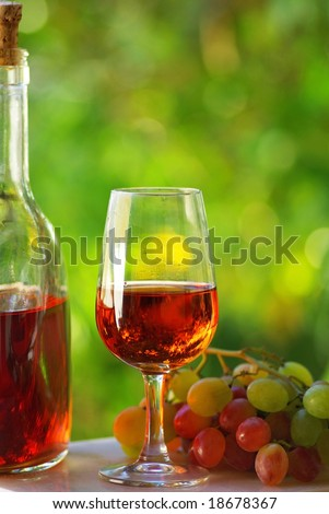 Portuguese rose wine and grapes. - stock photo