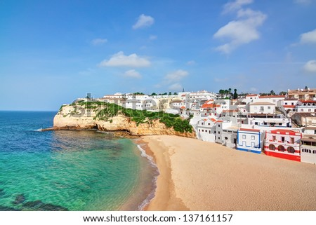Portuguese villa in Carvoeiro beach with clear blue sea. In the summer the top view. - stock photo