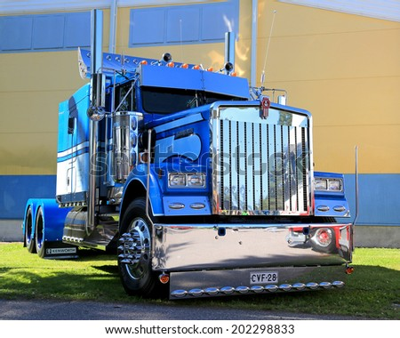 PORVOO, FINLAND - JUNE 28, 2014: Blue Kenworth show truck tractor on display at Riverside Truck Meeting 2014 in Porvoo, Finland. - stock photo