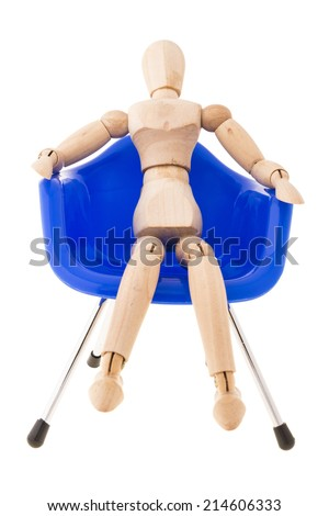 pose of wood figure comfortable sit on blue plastic chair on white background - stock photo