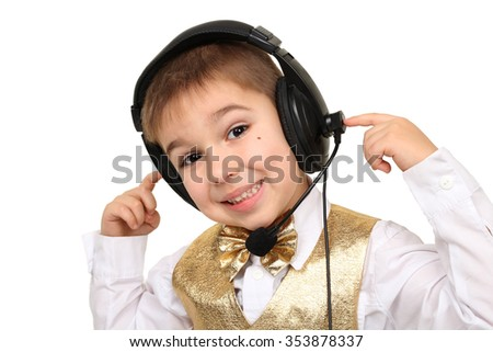 Posing with headset. Young boy is smiling while wearing headset. Man speaks into the microphone and looking at the camera. Support staff. Call center, phone. Work with the client via the Internet.  - stock photo