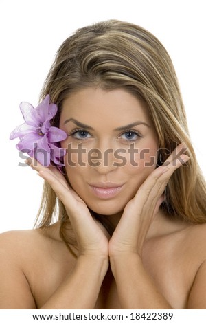 posing woman with flower in her hair - stock photo