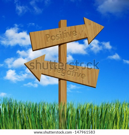 Positive and negative on wooden sign board - stock photo