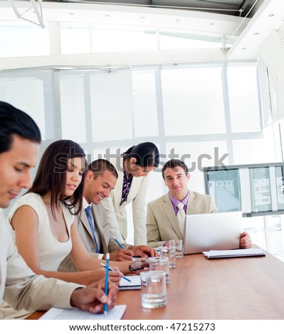 Positive business people having a meeting in a company - stock photo