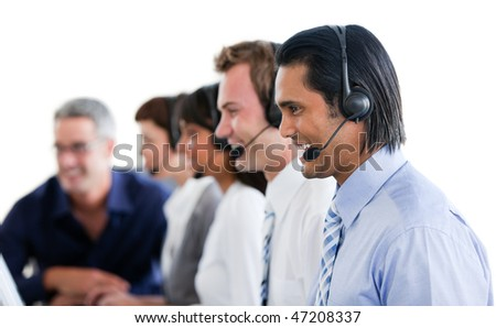Positive business people working in a call center against a white background - stock photo