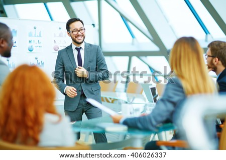 Positive CEO holding a meeting - stock photo