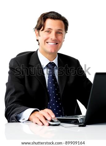 Positive confident businessman works on his laptop computer - stock photo