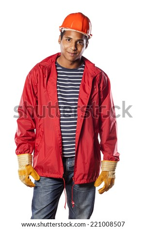 Positive dark-skinned worker with helmet and gloves - stock photo